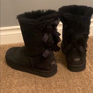 Black ugg boots lower calf with three black bows.